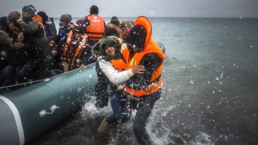 Refugees and migrants disembark on a beach on the Greek island of Lesbos in January.