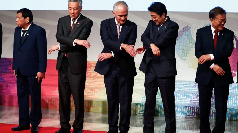 """'We're not Asian and shouldn't try to be': President of Philippines Rodrigo Duterte, Prime Minister of Singapore Lee Hsien Loong, Australian Prime Minister Malcolm Turnbull, Japanese Prime Minister Shinzo Abe and Republic of Korea President Moon Jae-in during the East Asia Summit """"family photo""""."""