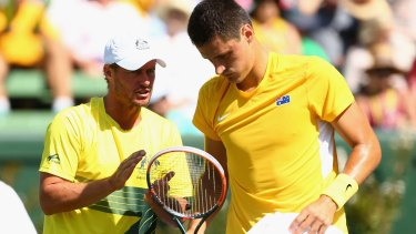 Pep talk:  Davis Cup captain Lleyton Hewitt with Australia's Bernard Tomic.