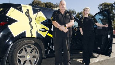 Event Medical Services head Michael Hammond, pictured with fellow paramedic Kris Wallace, has defended his company's stance.