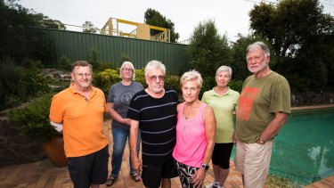 Residents John Hill, Alexandra Geue, Russell Johnson, Joan Johnson, Margaret Cooper and John Cooper are concerned about the construction of a building on a former Mr Fluffy site.