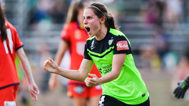 Canberra United's Ashleigh Sykes celebrates a goal against Adelaide United.