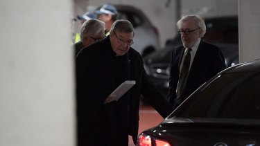 Cardinal George Pell leaves the car park of his lawyer's offices.