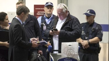 Andrew McManus being detained by police at Melbourne airport.