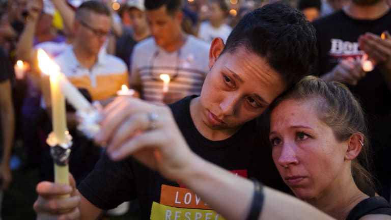 Jennifer, right, and Mary Ware light candles during a vigil for the victims of a mass shooting at Pulse nightclub in Orlando, Florida.