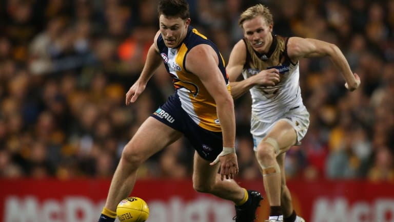 Traditional footballer: Jeremy McGovern only has eyes for the ball in the qualifying final against Hawthorn