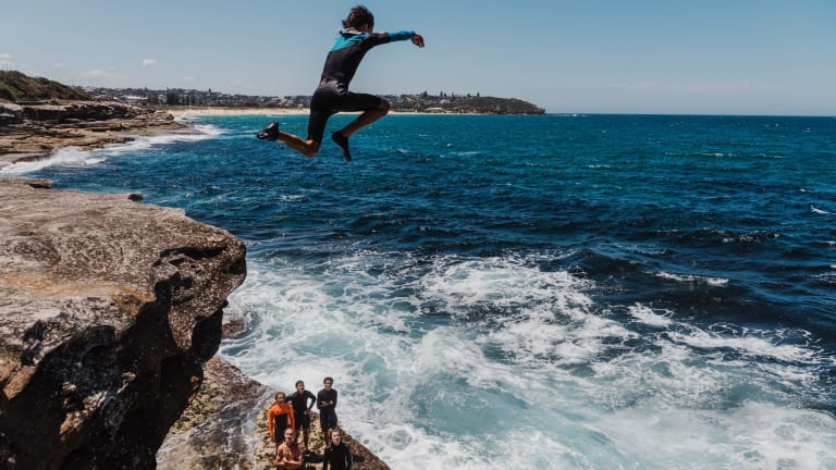 Teenagers enjoying the warm weather at South Curl Curl.