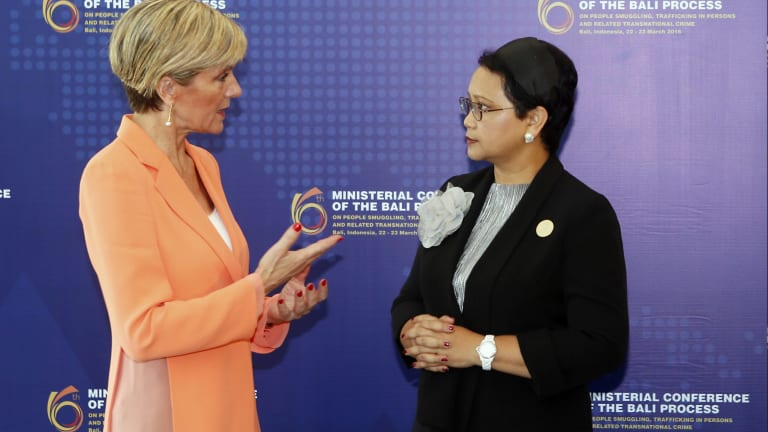 Indonesia Foreign Minister Retno Marsudi, right, listens to Julie Bishop during the Bali Process regional ministerial meeting in Bali.