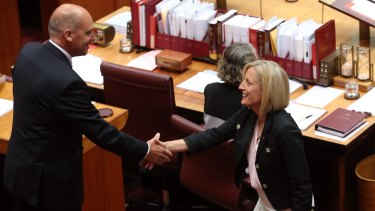 Katy Gallagher is congratulated by Senate president Senator Stephen Parry at Parliament House in Canberra on Thursday.