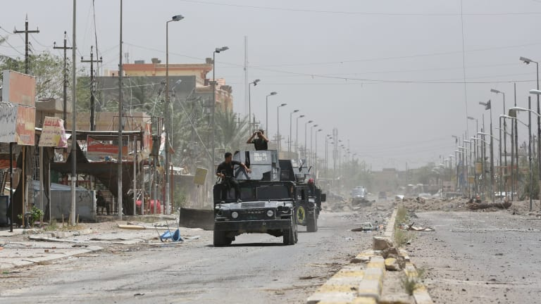 Iraqi counter-terrorism forces patrol Fallujah, Iraq on Monday, June 27.