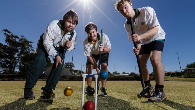 No money in it: Elite croquet players (left to right) Robert, Greg and Mal Fletcher of Dundonnell, practise at Lismore Croquet club in western Victoria.
