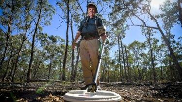 John Nalder puts his metal detector to work around Wedderburn.