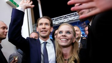Sebastian Kurz, leader of the People's Party (OeVP), and his girlfriend Susanne Thier celebrate victory in Vienna on Sunday.