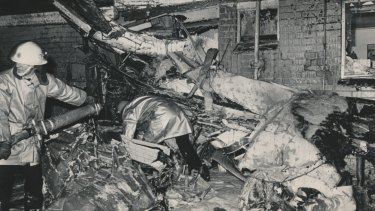 The plane wreckage wedged against the home of Giuseppe and Angela Corrso. Mrs Corrso suffered slight burns while their two children escaped injury.