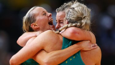 Renae Hallinan, Laura Geitz and Julie Corletto of the Diamonds celebrate victory in the 2015 Netball World Cup Gold Medal match.