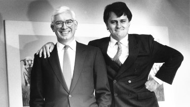 Nick Whitlam (left) and Malcolm Turnbull, who is standing on a phone book, at their private investment bank Whitlam Turnbull & Co in 1988.