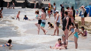 Crowds enjoy a summer's day on Eastern beach in Corio Bay, Geelong.