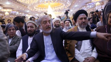 Afghan presidential candidate Abdullah Abdullah, centre, whose claims of vote rigging led to US intervention and a massive audit of Afghan votes.