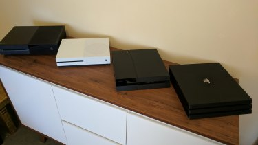 The Pro (right) is bulkier than the original PS4 and the new Xbox One S, although it's still not as big or heavy as the launch Xbox One (left).