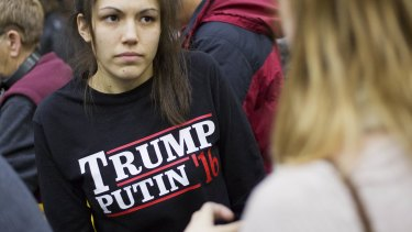 A woman wears a shirt reading 'Trump Putin '16' while waiting for Republican presidential candidate Donald Trump at Plymouth State University.
