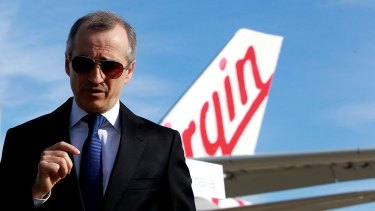 """Virgin boss, John (Massimo) Borghetti, picked up an AO for """"distinguished service"""" to the aviation industry, tourism development and as a """"supporter of the arts and sport""""."""