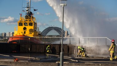 Helping hand: The fire was knocked over with the help of a Port Authority boat.