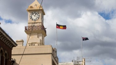 Flags flying over Richmond Town Hall, where Yarra Council took its controversial vote.