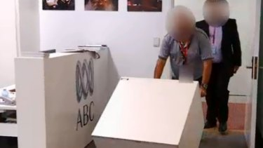 Intelligence officers from ASIO have reclaimed the documents from the ABC.
