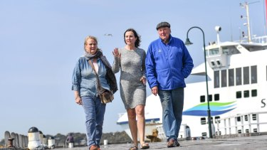Catherine O'Byrne (centre) with mother Nola Siemering and stepfather Don Siemering at the existing ferry terminal.