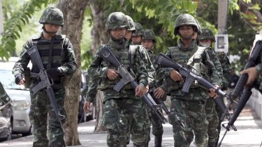 Thai soldiers march on a street in Bangkok. Thailand's junta chief has given the military broad new police-like powers to arrest and detain criminal suspects, in an unannounced move that rights groups criticised as a recipe for human rights violations.