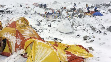 Climbers search through crushed tents in the aftermath of the avalanche at Everest base camp.