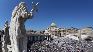 St Peter's Square is crowded with the faithful and with tourists.
