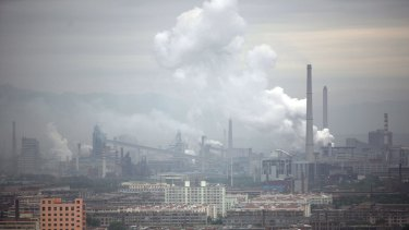 A coal-fired power plant spews emissions in Taiyuan, China.