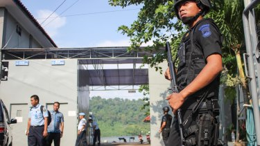 Nusakambangan, the island where the executions will take place, is visible through the gate as police wait for ambulances to arrive.