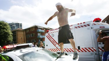 Troy Dennehy, pictured jumping on a police car, suicided two years after the riots.