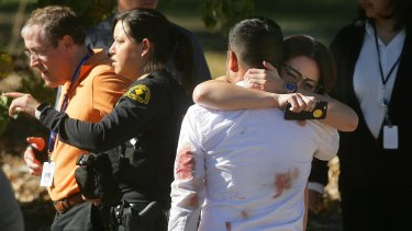 A couple embraces following the shooting.