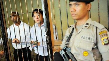 Sukumaran (left) and Chan behind bars.