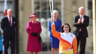 Sydney bound?  Anna Meares carries the baton at the launch of The Queen's Baton Relay for the XXI Commonwealth Games at Buckingham Palace. The 2022 edition may be coming to Sydney.