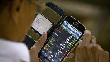 Checking stock prices via a smartphone.