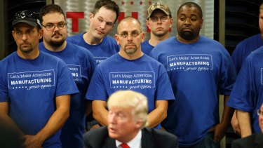 Workers at Staub Manufacturing listen as Donald Trump speaks on the campaign trail in Ohio in September.