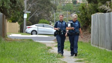Police at the sideline of chief steward Terry Bailey's house after shots where fired at his front door.