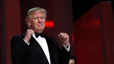 President Donald Trump acknowledges the crowd at the Liberty Ball, Friday, Jan. 20, 2017, in Washington. (AP Photo/Alex Brandon)