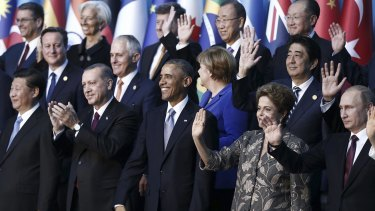 Front row L-R, Chinese President Xi Jinping, Turkish President Recep Tayyip Erdogan, U.S. President Barack Obama, Brazilian President Dilma Rousseff, Russian President Vladimir Putin, 2nd Row L-R,  British Prime Minister David Cameron, Australian Prime Minister Malcolm Turnbull, German Chancellor Angela Merkel, Japanese Prime Minister Shinzo Abe, 3rd row L-R, World Trade Organization (WTO) Director-General Roberto Azevedo , International Monetary Fund (IMF) Managing Director Christine Lagarde, Guy Ryder, Director General of International Labour Organisation (ILO), UN Secretary-General Ban Ki-moon and World Bank President Jim Yong Kim pose for a family photo during the G-20 summit in Antalya, Turkey, Sunday, Nov. 15, 2015. The 2015 G-20 Leaders Summit is held near the Turkish Mediterranean coastal city of Antalya on Nov. 15-16, 2015. (Aykut Unlupinar/Anadolu Agency via AP, Pool)