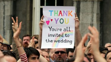 A supporter holds a sign during celebrations of the vote to legalise same-sex marriage in Ireland.