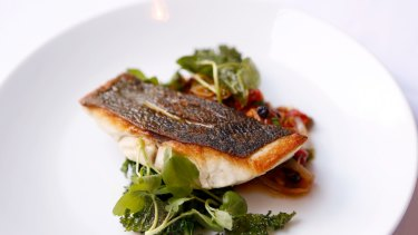 Blue eye cod with red pepper, currants, pine nuts and crispy kale.