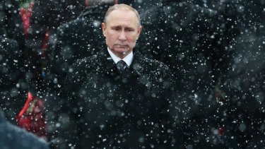 Snow falls as Russian President Vladimir Putin attends a wreath-laying ceremony at the Tomb of the Unknown Soldier in Moscow, Russia.