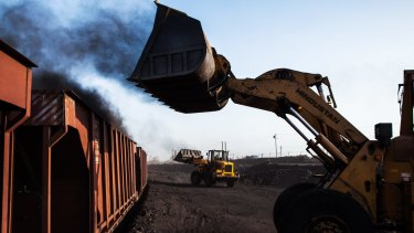 Loaders fill railcars with coal at a depot in Jharkhand, India. The longevity of the price rally will, of course, depend on how long it takes for lower cost supply to come back into the market.
