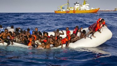 Migrants call for help from a sinking dinghy off the coast of the Italian island of Lampedusa on Sunday.