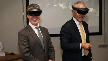 Then innovation minister Christopher Pyne and Prime Minister Malcolm Turnbull don mixed reality goggles at Saab in Adelaide on the election campaign trail in June.
