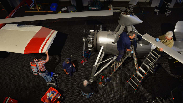 Powerhouse Museum staff take apart an autogiro and a Transavia Airtruk.